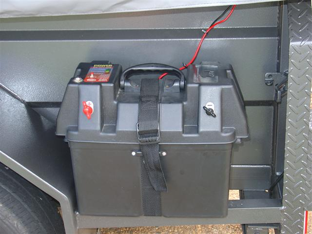 The Battery Box Is Bolted To A Frame At The Rear Of The